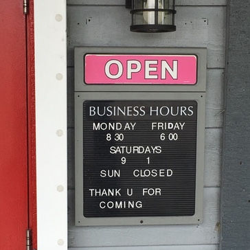 "Business ""open"" sign with open hours"